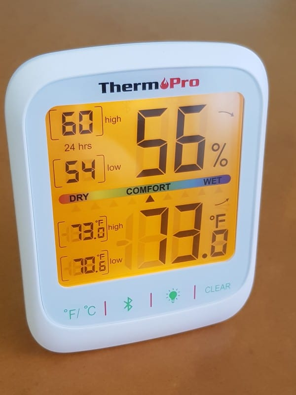 ThermoPro TP59 indoor temperature and humidity monitor with backlight on